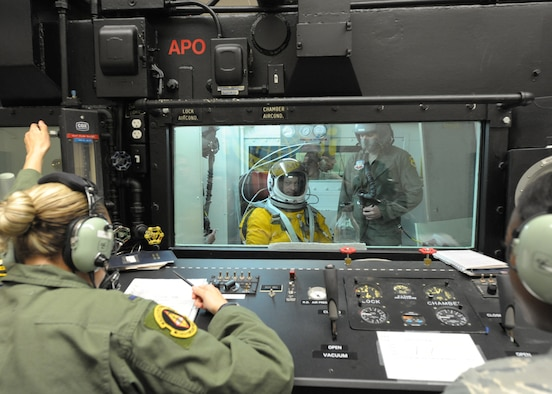 Airmen from the 9th Physiological Support Squadron operate the altitude chamber at Beale Air Force Base, Calif., June 7, 2011 while Gary Sinise, actor and military supporter, prepares to experience loss of cabin pressure at 70,000 feet elevation in preparation for a high flight in the U-2 Dragon Lady. Mr. Sinise was visiting Beale to document the mission of the U-2 Dragon Lady and meet with Airmen to boost morale.