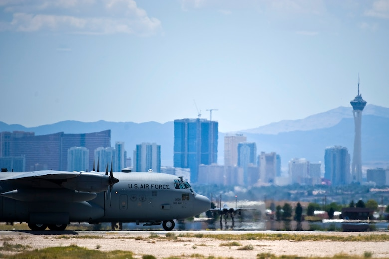 NELLIS AIR FORCE BASE, Nev.-- A C-130 Hercules assigned the U.S. Air Force Weapons School taxis across the Nellis Flightline during the Mission Employment phase, June 8, 2011. More than 5,000 personnel are involved in the final phase of the Weapons School graduate course, resulting in 89 students from 21 separate combat specialties graduating as U.S. Air Force Weapons Officers. (U.S. Air Force photo by Senior Airman Brett Clashman)