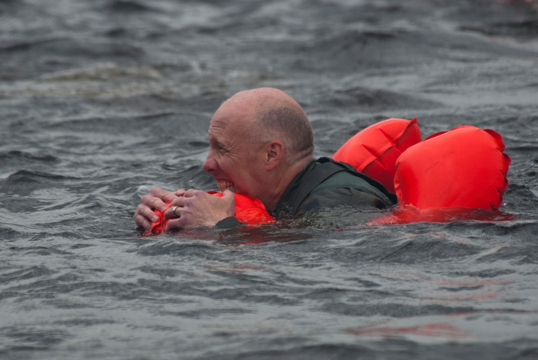 Lt. Col. Daniel E. Gabrielli swims gripping his aircrew life preserver in the bone chilling waters of the St. Croix River during water survival training 11 June, 2011 in the St. Croix River Afton State Park, Hastings, Minn. Sixty-two members of the 133rd Airlift Wing, Minnesota Air National Guard are taking part in their annual survival training at Afton State Park, Hastings Minn. including survival equipment, lift raft familiarization, parachute disentanglement and rescue techniques. U.S. Air Force Photo by Tech. Sgt. Erik Gudmundson (released)