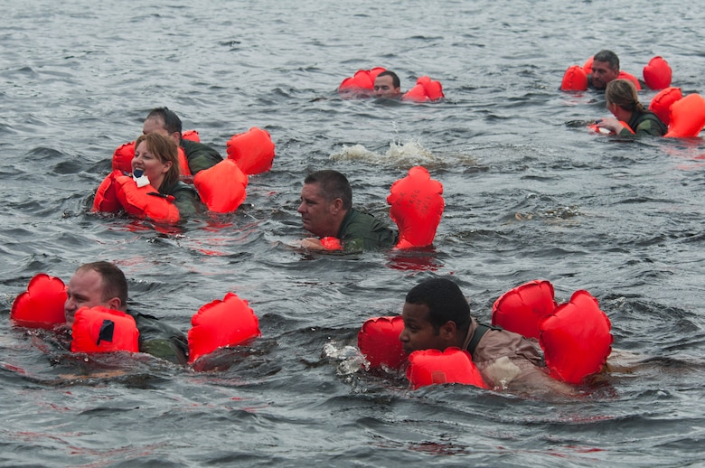 Air Crew members swim in the frigid waters of the St. Croix River with their aircrew life preserver keeping them afloat. Sixty-two members of the 133rd Airlift Wing, Minnesota Air National Guard are taking part in their annual survival training at Afton State Park, Hastings Minn. including survival equipment, lift raft familiarization, parachute disentanglement and rescue techniques. U.S. Air Force Photo by Tech. Sgt. Erik Gudmundson (released)