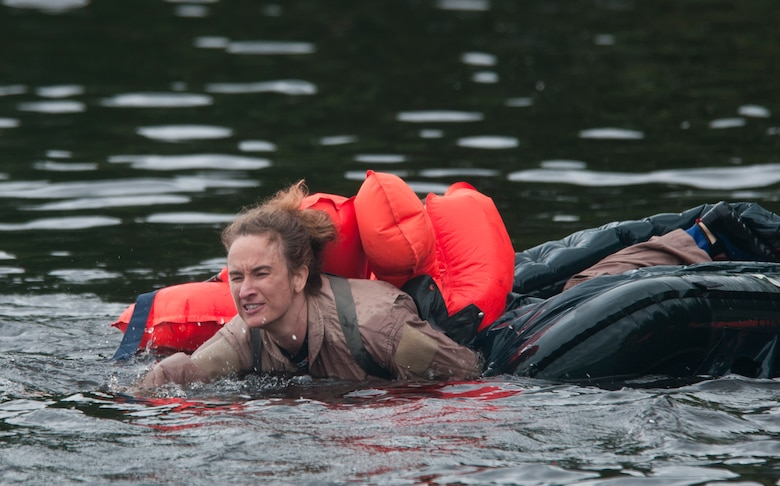 Tech Sgt. Jill Shepard crawls from a one person life raft back into the cold waters of the St. Croix River Afton State Park, Hastings Minn. Sixty-two members of the 133rd Airlift Wing, Minnesota Air National Guard are taking part in their annual survival training at Afton State Park, Hastings Minn. including survival equipment, lift raft familiarization, parachute disentanglement and rescue techniques. U.S. Air Force Photo by Tech. Sgt. Erik Gudmundson (released)