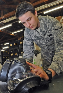 SPANGDAHLEM AIR BASE, Germany – Airman Brooke Wilson, 52nd Logistics Readiness Squadron individual protective equipment apprentice, annotates the serial number of a gas mask during a 100 percent equipment inventory at the mobility warehouse June 7. The inventory was one step of a web migration checklist issued by U.S. Air Forces in Europe will take place July 5-22.. (U.S. Air Force photo/Senior Airman Nick Wilson)