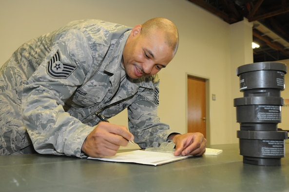 SPANGDAHLEM AIR BASE, Germany – Tech. Sgt. Kenton Ellis, 52nd Logistics Readiness Squadron individual protective equipment NCO in charge, annotates an IPE check sheet during a 100 percent inventory at the IPE warehouse June 7. The inventory was one step of a web migration checklist issued by U.S. Air Forces in Europe that will take place July 5-22.. (U.S. Air Force photo/Senior Airman Nick Wilson)