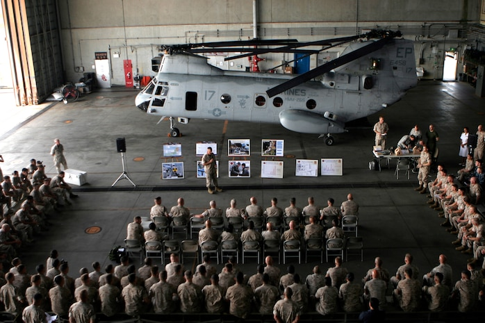 Marines with Marine Medium Helicopter Squadron 265, 31st Marine Expeditionary Unit, brief the Commandant of the Marine Corps Gen. James F. Amos, June 14, about their participation in Operation Tomodachi. The squadron recently attached to the 31st MEU as the incoming air combat element, and will be providing support throughout future deployments. The 31st MEU is the only continually forward-deployed MEU, and remains the nation's force-in-readiness in the Asia-Pacific region.