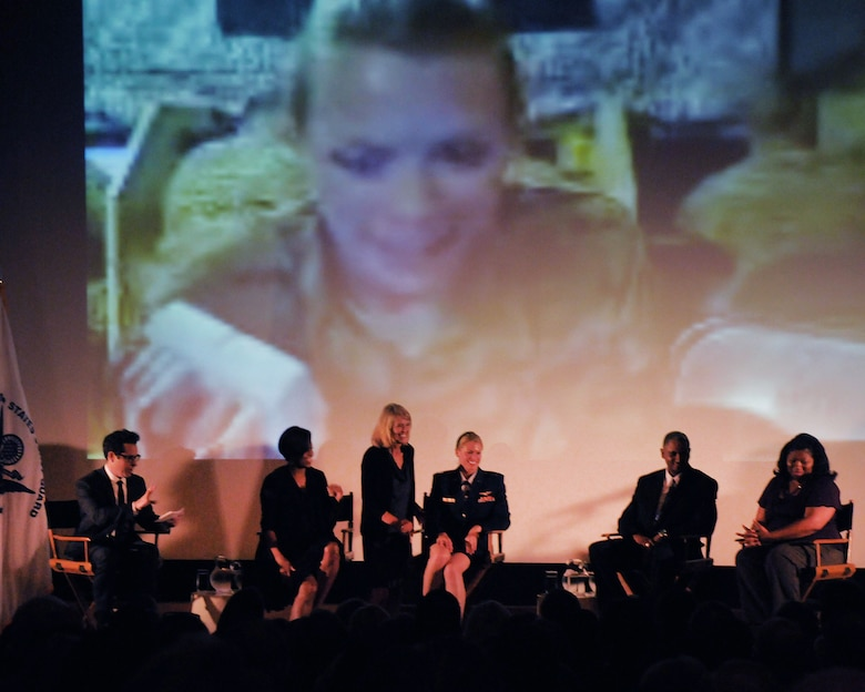 """Capt. Kelly Smith, C130 pilot with the 146th Airlift Wing, receives a surprise """"skype"""" visit with her sister next to First Lady Michelle Obama during a panel discussion held June 13, 2011 at the Writers' Guild Theater in Beverly Hills. The First Lady asked writers and producers in the film industry to support the military and their families by sharing their compelling stories and using them in their plotlines. (Photo by Master Sgt. Dave Buttner)"""