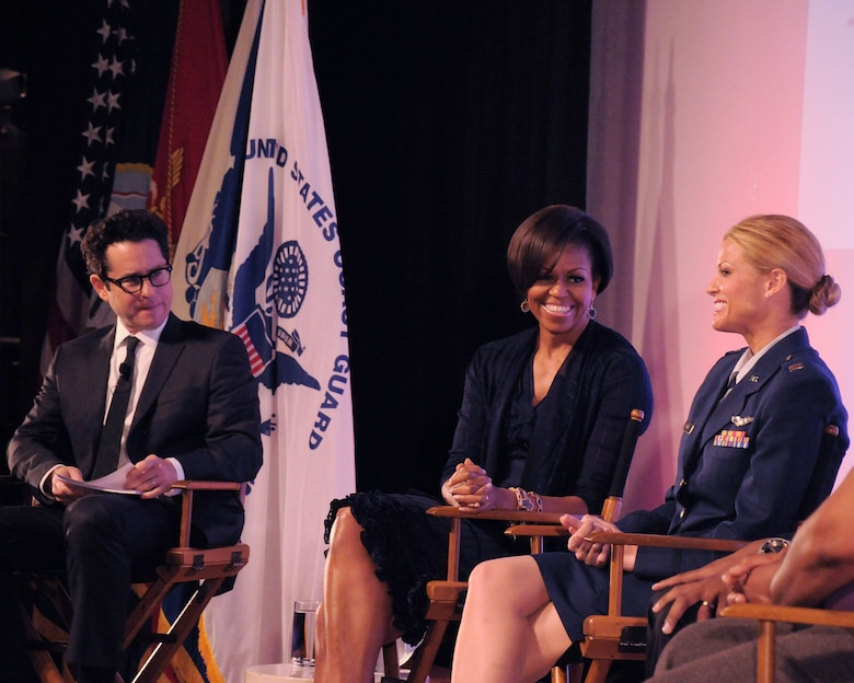 Capt. Kelly Smith, C130 pilot with the 146th Airlift Wing, speaks with First Lady Michelle Obama and J.J. Abrams, a Hollywood writer/producer, during a panel discussion held June 13, 2011 at the Writers Guild Theater in Beverly Hills. The First Lady asked writers and producers in the film industry to support the military and their families by sharing their compelling stories in their plotlines. (Photo by Master Sgt. Dave Buttner)