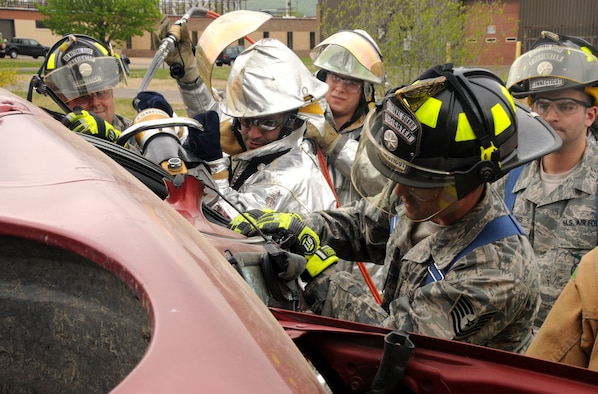 Connecticut Air National Guardsmen assigned to the 103rd Civil Engineer Squadron perform a vehicle extrication drill at Bradley Air National Guard Base, East Granby, Conn., May 14, 2011. Simulating a victim trapped inside, the Airmen use special tools to peel back the roof of the vehicle to free the victim from the wreckage. (U.S. Air Force photo by Airman 1st Class Emmanuel Santiago)