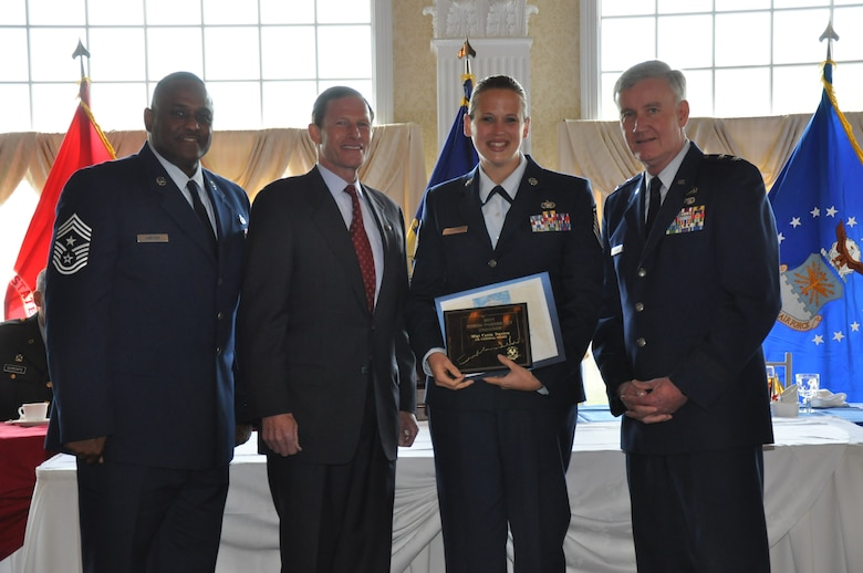 Chief Master Sgt. John Carter, Conn. State Command Chief—JFHQ, U.S. Senator for Connecticut, Richard Blumenthal and Maj. Gen. Thad Martin, The Adjutant General, pose with Master Sgt. Carrie Traverse, 103rd Air Control Squadron, after she was recognized for distinguished service during the 62nd annual Armed Forces Day Luncheon at the Aqua Turf Club in Southington May 20, 2011. (Photo by 2nd Lt. Emily Hein)