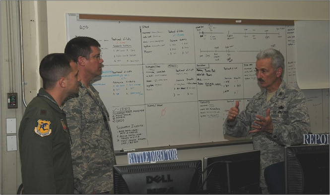 Maj. Evan Hunt and Col. Peter DePatie, both of the 103rd Air and Space Operations Group, discuss exercise integration on the AOG's operations floor with 103rd Airlift Wing vice commander, Col. Fred Miclon, at Bradley Air National Guard Base, East Granby, Conn. May 27, 2011. (U.S. Air Force Photo by Airman 1st Class Emmanuel Santiago)