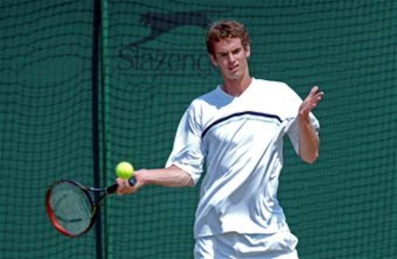 Andy Murray of Scotland prepares to hit a shot on the practice courts during the 2005 Wimbledon Championships held in London, England. (Photo courtesy of Tony Tolley)