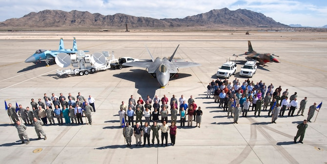 Members of the 98th Range Wing pose for a group photo on the Nellis flightline March 15. The 98 RANW was activated at Nellis Air Force Base Oct. 29, 2001 to operate, maintain and manage the NTTR complex. June 21, the 98 RANW legacy will live on at Nellis, but the name will change as the unit is re-designated as The Nevada Test and Training Range--a direct reporting unit to the U.S. Air Force Warfare Center. (U.S. Air Force photo by Airman 1st Class Jamie Nicley)