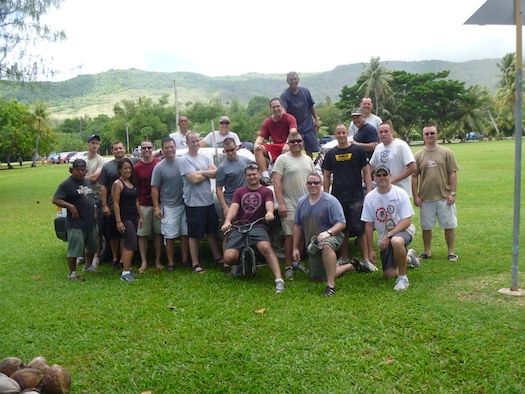 Members of the 96th Expeditionary Bomb Squadron, deployed here in support of Pacific Command's Continuous Bomber Presence, posed after conducting a clean-up at Nimitz Beach. The unit has undertaken a 9+6 Beach Cleanup project aimed at cleaning nine coastal village beaches and six military beaches on the island.