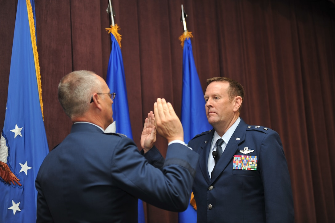 SCOTT AFB, Ill. - Lt. Gen. Robert R. Allardice, Commander, 18th Air Force, administers the Oath of Office to Maj. Gen. Robert K. Millmann, Jr., shortly after his promotion on June 10, 2011.