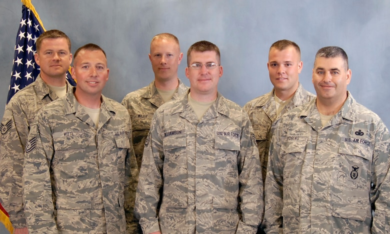 Members of the South Dakota Air National Guard Combat Pistol and Rifle Team are; back row, left to right, Staff Sgt. Joshua Nelson, Tech. Sgt. Jeremy Wajer, Staff Sgt. Adam Witte. Front row, left to right, Tech. Sgt. Michael Witte, Staff Sgt. Jason Williamson, and Master Sgt. Chad Rydberg.(Photo by Master Sgt. Nancy Ausland)(RELEASED)