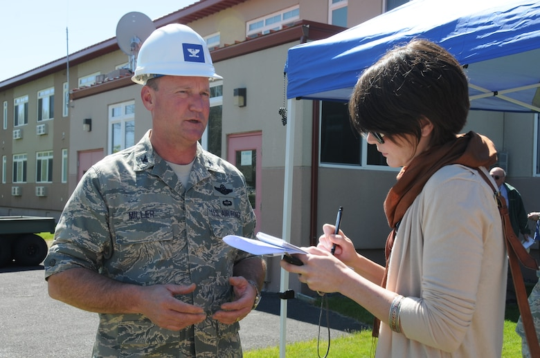 Col. James Miller, 173rd Fighter Wing Commander, is interviewed by Herald and News reporter Sara Hottman June 9, 2011 at Kingsley Field, Klamath Falls, Ore. during the ground breaking ceremony for the Joint Armed Forces Reserve Center.  When completed the building will house the 173rd Security Forces Squadron and Charlie Troop, 1-82nd Cavalry, Oregon Army National Guard.  (U.S. Air Force Photo by Tech. Sgt Jennifer Shirar) RELEASED