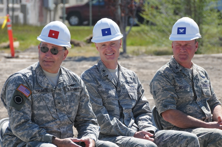 Brig. Gen. Charles L. Yriarte, Oregon Army National Guard Land Component Commander, Brig. Gen. Steven D. Gregg, Oregon Air National Guard Commander, and Col. James Miller, 173rd Fighter Wing Commander, listen to Oregon Senator Ron Wyden speak during the ground breaking ceremony for the Joint Armed Forces Reserve Center June 9, 2011 at Kingsley Field, Klamath Falls, Ore.  When completed the building will house the 173rd Security Forces Squadron and Charlie Troop, 1-82nd Cavalry, Oregon Army National Guard.  (U.S. Air Force Photo by Tech. Sgt Jennifer Shirar) RELEASED
