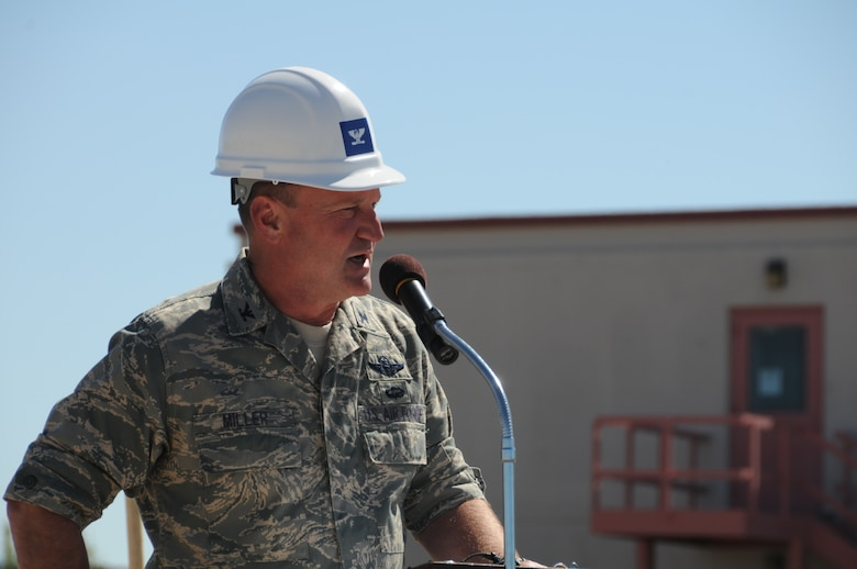 Col. James Miller, 173rd Fighter Wing Commander, speaks about the significance of Joint Armed Forces Reserve Center (JAFRC) June 9, 2011 at Kingsley Field, Klamath Falls, Ore. during the ground breaking ceremony for the JAFRC.  When completed the building will house the 173rd Security Forces Squadron and Charlie Troop, 1-82nd Cavalry, Oregon Army National Guard.  (U.S. Air Force Photo by Tech. Sgt Jennifer Shirar) RELEASED