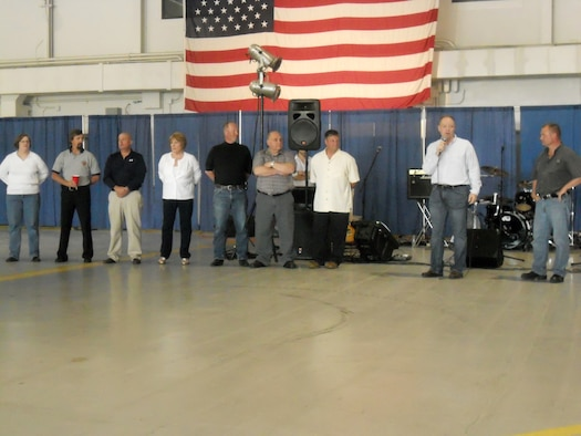 """U.S. Air Force Col. Kevin W. Bradley (second from right) expresses his gratitude to all the retiring chief master sergeants at Hancock Field Air National Guard Base in Syracuse NY, on 4 June 2011.  The Wing held a """"Hail to the Chiefs"""" dinner and ceremony for all chiefs who have or will retire in 2010-11. (U.S. Air Force photo by Staff Sgt. Takeya Williams)"""