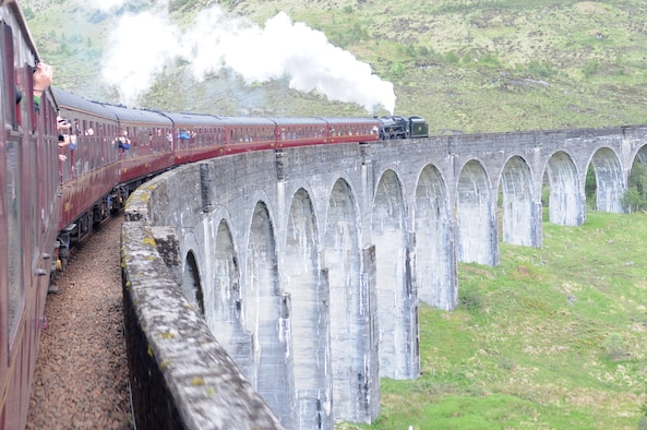 "HIGHLANDS, Scotland – A train crosses the Glenfinnan Viaduct on May 30, 2011. Participants on the RAF Lakenheath Outdoor Recreation ""Harry Potter and Loch Ness"" trip rode round trip on the Jacobite Railway from Fort Williams to Mallaig, Scotland. This location was featured in the Harry Potter movies. (U.S. Air Force photo/Staff Sgt. Stephen Linch)"