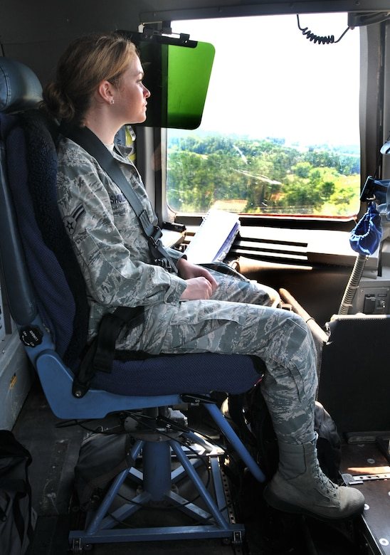 Airman 1st Class Maechelle Shuler, from the 628th Air Base Wing legal office, looks outside the window of a C-17??s cockpit during landing June 15 at Joint Base Charleston - Northfield. During the flight training mission, 32 Airmen and two civilians from the 437th Airlift Wing and the 628th Air Base Wing participated in a quarterly C-17 incentive flight. (U.S. Air Force photo/ Airman 1st Class Jared Trimarchi)