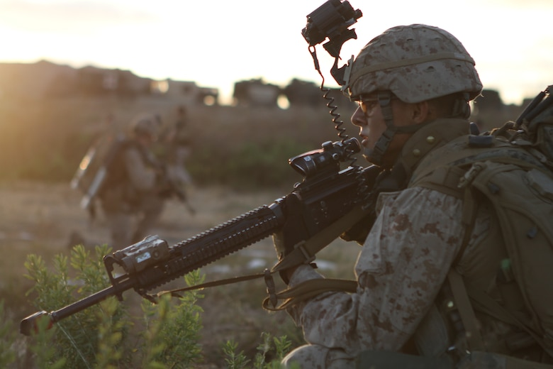 Pfc. Enrique Correa provides security while rehearsing for a night raid here June 19. Correa, an 18-year-old Yuma, Ariz., native, serves as a Rifleman with Company L, one of three rifle companies in Battalion Landing Team 3/1, the ground-combat element for the 11th Marine Expeditionary Unit. The unit recently began its first full-scale exercise since becoming a complete Marine air-ground task force in May.