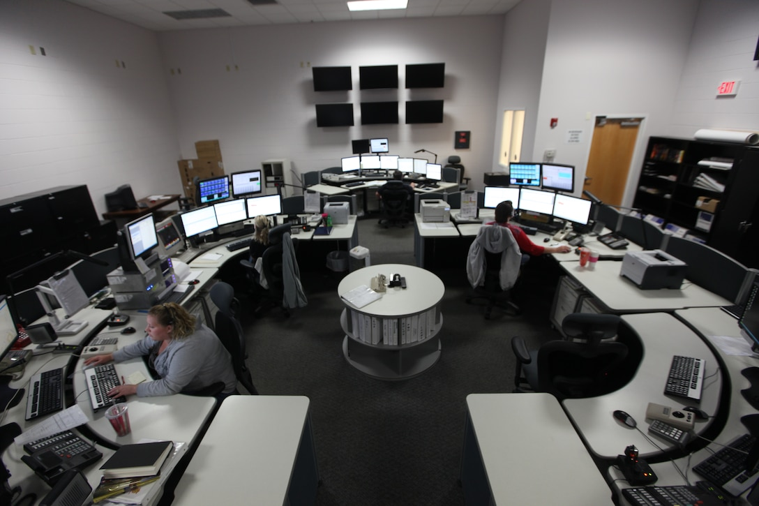Amanda Scott (front left), Angela Wade (back left) and Sheryl Ripley (back right) man the core of the Marine Corps Base Camp Lejeune 911 Emergency Consolidated Communications Center.  The center is responsible for 911 calls from Marine Corps Base Camp Lejeune, Marine Corps Air Station New River and the satellite facilities.
