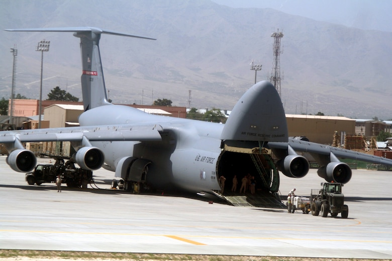 Airmen work on a C-5 Galaxy at Bagram Airfield, Afghanistan, on June 6, 2011. The C-5 is the Air Force's largest airlift aircraft. (U.S. Air Force Photo/Master Sgt. Scott T. Sturkol)