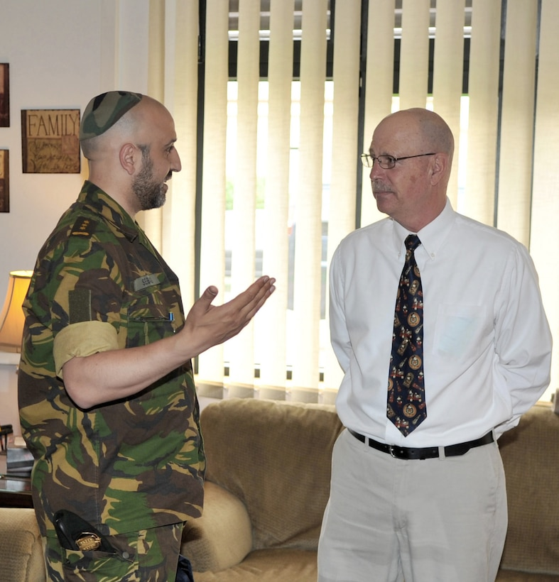 Col. (Rabbi) Menachem Sebbag (left), the Netherlands armed forces chief of Jewish chaplains, speaks with Rick Deppe, the Airmen Ministries coordinator for Club 7, during the NATO Allied Air Force Chaplains Consultative Committee Conference at Ramstein Air Base, Germany, June 16, 2011. (U.S. Air Force photo/Senior Airman Caleb Pierce)