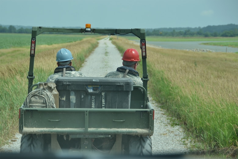 An airman from the Missouri Air National Guard and a soldier from the Kansas National Guard drive along federal levee 471-460-R near St. Joseph, Mo., June 20, 2011. The Missouri and Kansas National Guards are providing joint levee patrol on an approximately 10 mile stretch along the Missouri River. (U.S. Air Force photo by Staff Sgt. Michael Crane)