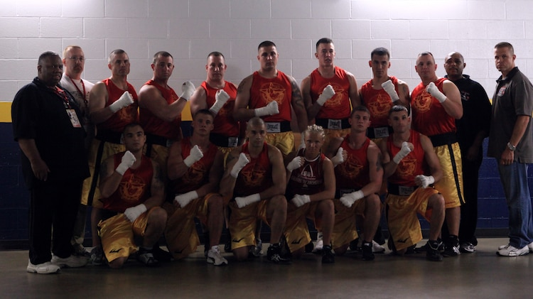 Members of the Marine amateur boxing team get together just before the First to Fight boxing match in St. Louis June 20, 2011. The team was made up of 13 Marines who got the chance to battle police officers and firefighters during the competition.