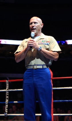 Lt. Col. Todd S. Tomko, commander of the Special Purpose Marine Air Ground Task Force Marine Week, sings the national anthem before the beginning of the First to Fight tournament in St. Louis June 20, 2011. First to Fight gave Marines a chance to box local police officers and firefighters while at the same time raising money for charity.