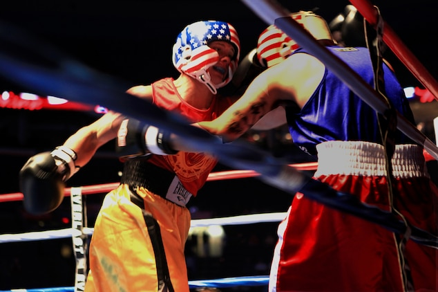 Lance Cpl. Dennis Wiatt, a data technician specialist with 3rd Battalion, 24th Marine Regiment, Special Purpose Marine Air Ground Task Force Marine Week, deals a blow to his opponent during the First to Fight amateur boxing tournament in St. Louis June 20, 2011. Wiatt was one of 13 Marines who fought local police officers and firefighters to raise money for Toys for Tots, Backstoppers and the Semper Fi Society of St. Louis.