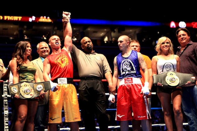 Lance Cpl. Dennis Wiatt, a data technician specialist with 3rd Battalion, 24th Marine Regiment, Special Purpose Marine Air Ground Task Force Marine Week, is named the winner of his match during the First to Fight boxing competition in St. Louis June 20, 2011. Wiatt, although an inexperienced fighter, showed tenacity and heart to come out on top of his opponent.