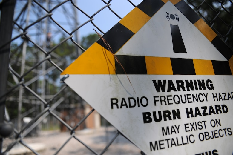 photo essay airmen participate in radio tower training > u s air  a sign warns ors of danger near a radio frequency tower at joint base charleston