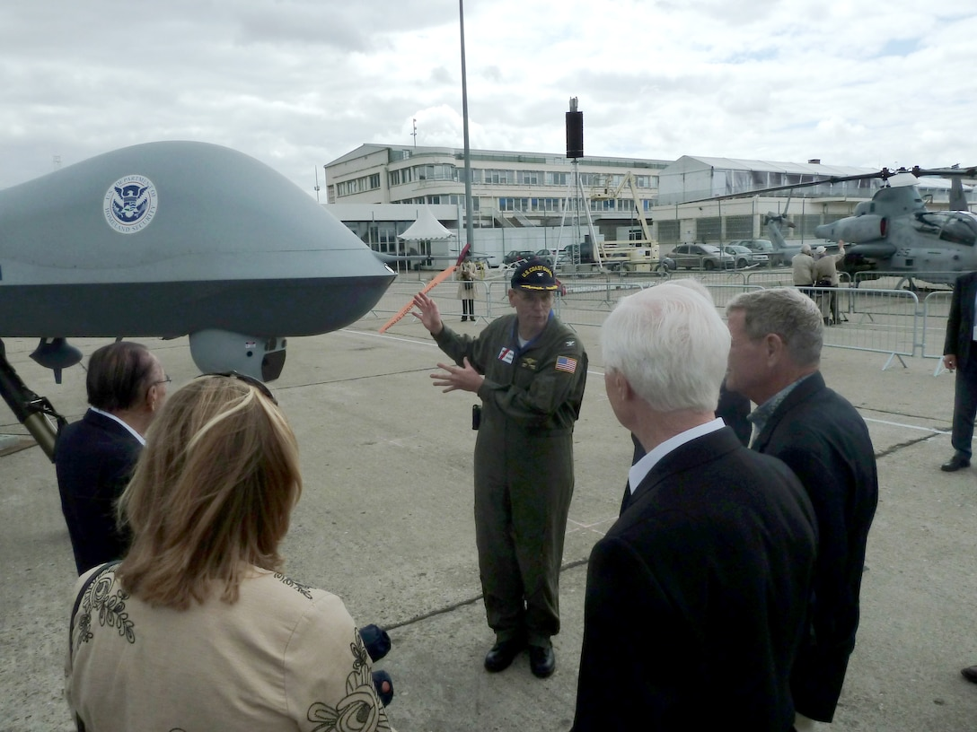 U.S. Coast Guard Capt. James Sommer explains the role of the MQ-9 Predator B (Guardian) unmanned aerial system to a Congressional delegation June 19, 2011, during the 49th International Paris Air Show at the Le Bourget Airport in Paris. The Predator B (Guardian) is operated by the U.S. Customs and Border Protection and the U.S. Coast Guard for the Department of Homeland Security. (U.S. Air Force photo/Tech. Sgt. Francesca Popp)