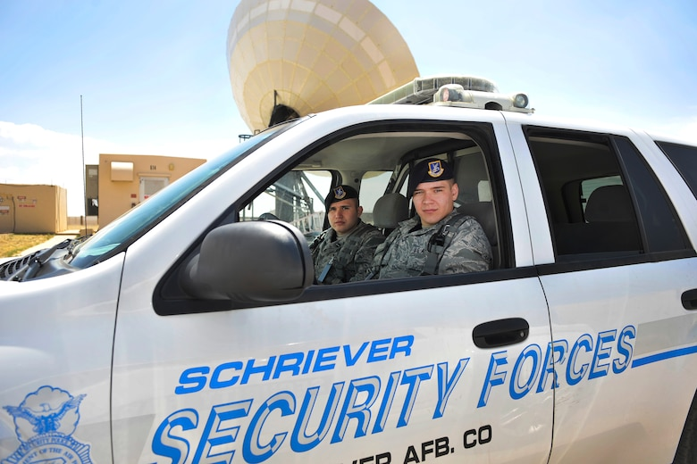 SCHRIEVER AIR FORCE BASE, Colo. -- Airmen First Class Andrew Beer (driver) and Ryan Bursiaga, 50th Security Forces Squadron Security specialists, keep watch over 50th Space Wing assets while on patrol June 15. (U.S. Air Force Photo/Dennis Rogers)