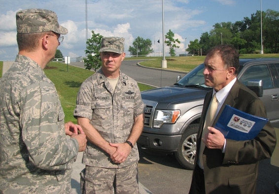 Brig. Gen. Anthony P. German, Chief of Staff of the New York Air National Guard, and Col. John Bartholf, Commander, Eastern Air Defense Sector, talk with Congressman Richard Hanna during his visit to EADS on June 17.