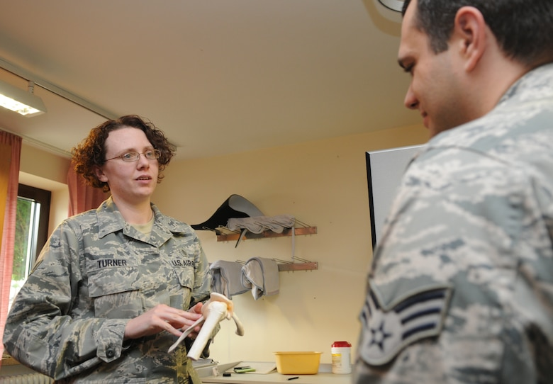 SPANGDAHLEM AIR BASE, Germany – Tech. Sgt. Jaime Turner, 52nd Medical Operation Squadron physical therapy NCO in charge, explains to Senior Airman Jarrod Garceau, 52nd MDOS physical therapy technician, about the shoulder bone structure and common shoulder injuries that occur among patients here June 13. The 52nd MDOS Physical Therapy Section is available to lend a hand when it comes to helping patients alleviate pain and regain their physical abilities. (U.S. Air Force photo/Senior Airman Nick Wilson)