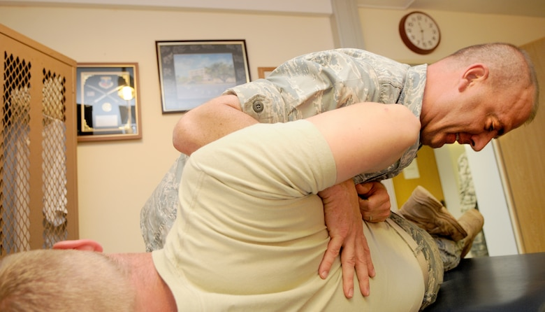 SPANGDAHLEM AIR BASE, Germany – Maj. Michael Hobson, 52nd Medical Operation Squadron physical therapist, performs therapy to alleviate the back pain of Airman 1st Class Aaron Demmon, 52nd Civil Engineer Squadron here June 13. The 52nd MDOS Physical Therapy Section is available to lend a hand when it comes to helping patients alleviate pain and regain their physical abilities. (U.S. Air Force photo/Senior Airman Nick Wilson)