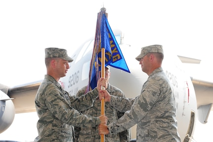 Maj. Ryan White accepts the 437th Aircraft Maintenance Squadron guidon from Col. James Clavenna at the 437 AMXS Change of Command June 21 at Joint Base Charleston. Major White is the new 437 AMXS commander and Col. Clavenna is the 437th Maintenance Group Commander. (U.S. Air Force photo/ Tech. Sgt. Chrissy Best)