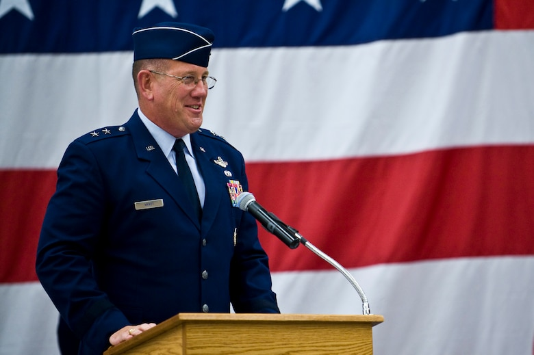 U.S. Air Force Maj. Gen. Bill Hyatt, U.S. Air Force Warfare Center commander, recognizes the contributions of the men and women of the 98th Range Wing during a ceremony re-designating the unit The Nevada Test and Training Range at Nellis Air Force Base, Nev., June 21, 2011. Col. Kenneth Thompson, former defense and air attaché to the U.S. Embassy in Cairo, assumed command of the NTTR during the event. Like the 98 RANW, The NTTR will remain a direct reporting unit to the U.S. Air Force Warfare Center and continue to operate, maintain and manage the 2.9-million-acre range (42 percent of the land managed by the U.S. Air Force) and 12,000 square miles of military airspace. More than 1,000 military, civilian and contract personnel are assigned to the organization. (U.S. Air Force photo by Senior Airman Brett Clashman/Released)