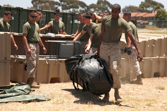 Marines and sailors with the 15th Marine Expeditionary Unit (MEU) set up tents for a command operations center. The unit set up the tents for a Command Post Exercise (CPEX) here at Camp Del Mar, June 20-23.