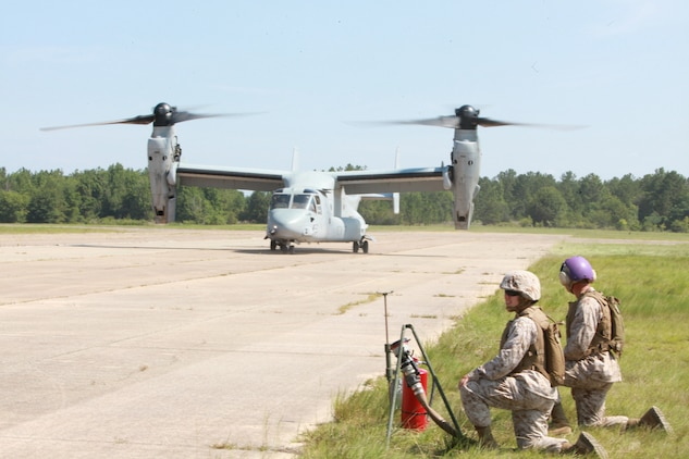 Marine Wing Support Squadron 273 bulk fuels Marines work to field hot refuel a MV-22 Osprey June 23during Excercise Mailed Fist at Vidalia Municipal Airport. The work fuels speacialists ensure that Marine Corps equipment is proper field with high quality fuel to ensure the mission can be completed.