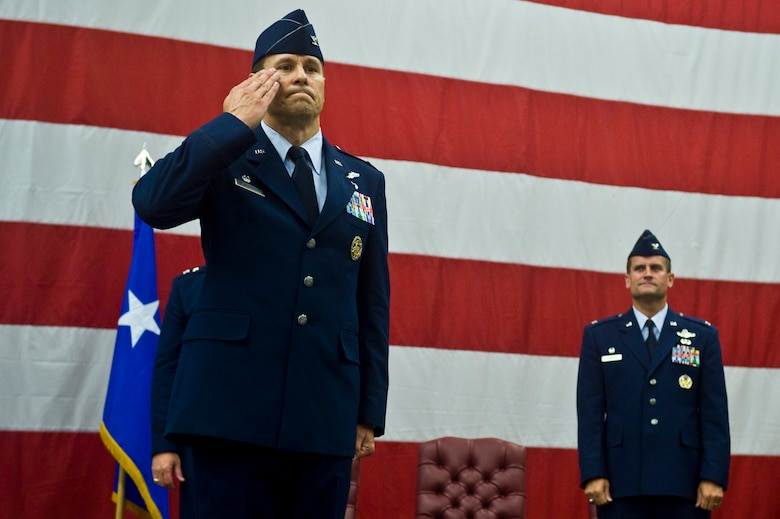 U.S. Air Force Col. John Montgomery, outgoing 98th Range Wing commander, renders a final salute to his wing at Nellis Air Force Base, Nev., June 21, 2011. During the event, the 98th Range Wing was officially re-designated the Nevada Test and Training Range and will remain a direct reporting unit to the U.S. Air Force Warfare Center. The NTTR will continue to operate, maintain and manage the 2.9-million-acre range (42 percent of the land managed by the U.S. Air Force) and 12,000 square miles of military airspace. More than 1,000 military, civilian and contract personnel are assigned to the organization. (U.S. Air Force photo by Senior Airman Brett Clashman/Released)