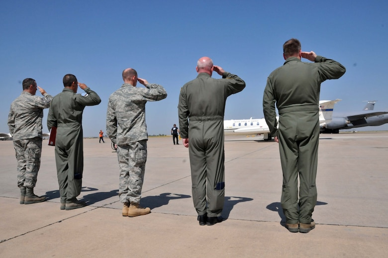 Col. Edward E. Metzgar, 313th Air Expeditionary Wing commander, along with his senior staff members render hand salute as Maj. Gen. Margaret H. Woodward, Commander, 17th Air Force (U.S. Air Forces Africa) arrive at an air base in Western Europe on June 21, 2011. (U.S. Air Force photo/Capt. John P. Capra)