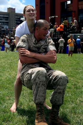 Wendy, a native of St. Louis, struggles to buddy drag Lance Cpl. Matt Spires, a squad automatic rifleman with 3rd Battalion, 24th Marine Regiment during the Combat Fitness Test outside Busch Stadium June 23, 2011. Locals were invited to participate in the CFT as part of Marine Week St. Louis activities.