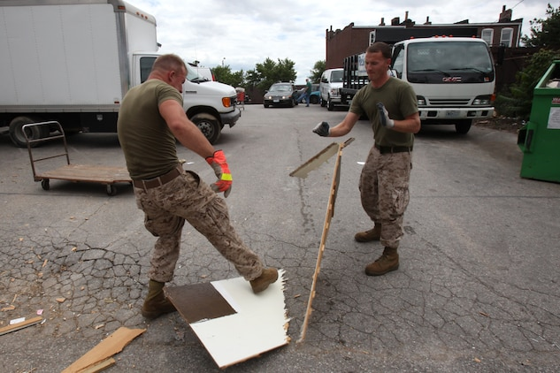 Lance Cpl. Daniel Richardson and Lance Cpl. William Foust break a large piece of old furniture, readying it for disposal, June 23. The Marines were at the Habitat for Humanity ReStore, a center dedicated to providing low-cost building materials, furniture and other supplies. They supported the store by organizing donated materials and disposing of unserviceable furniture, allowing better access to the items.
