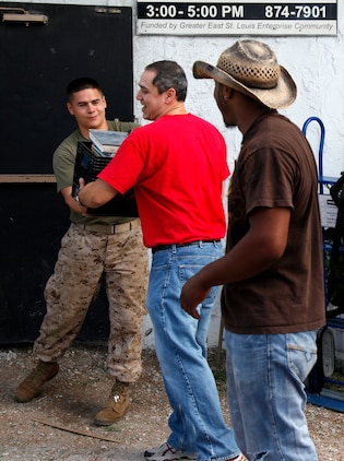 Marines with 3rd Battalion, 24th Regiment, work with local volunteers to move a youth center into its new building, giving back to the community at Washington Park, East St. Louis, Ill. The service was part of  Special Purpose Marine Air Ground Task Force Marine Week St. Louis, giving Marines an opportunity to increase public awareness of the Marine Corps' value to our nation's defense and to preserve and mature the Corps' relationship with the American people.