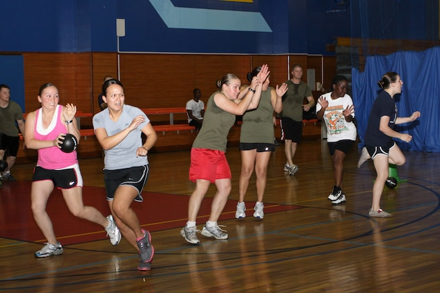 Team members from RMD Supply B attempt to dodge the ball as they participated inthe round-robin dodgeball tournament at the IronWorks Gym sports courts here June 24. They were unable to win a game but held on throughout the tournament .