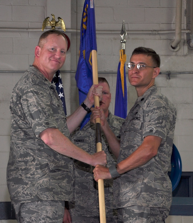 Lt. Col. Craig Punches accepts the 628th Logistics Readiness Squadron guidon from Col. Benjamin Wham during the 628 LRS Change of Command June 23 at Joint Base Charleston. Colonel Punches is the new 628 LRS commander and Colonel Wham is the 628th Mission Support Group commander. (U.S. Air Force photo/ Tech. Sgt. Robert Gibson)